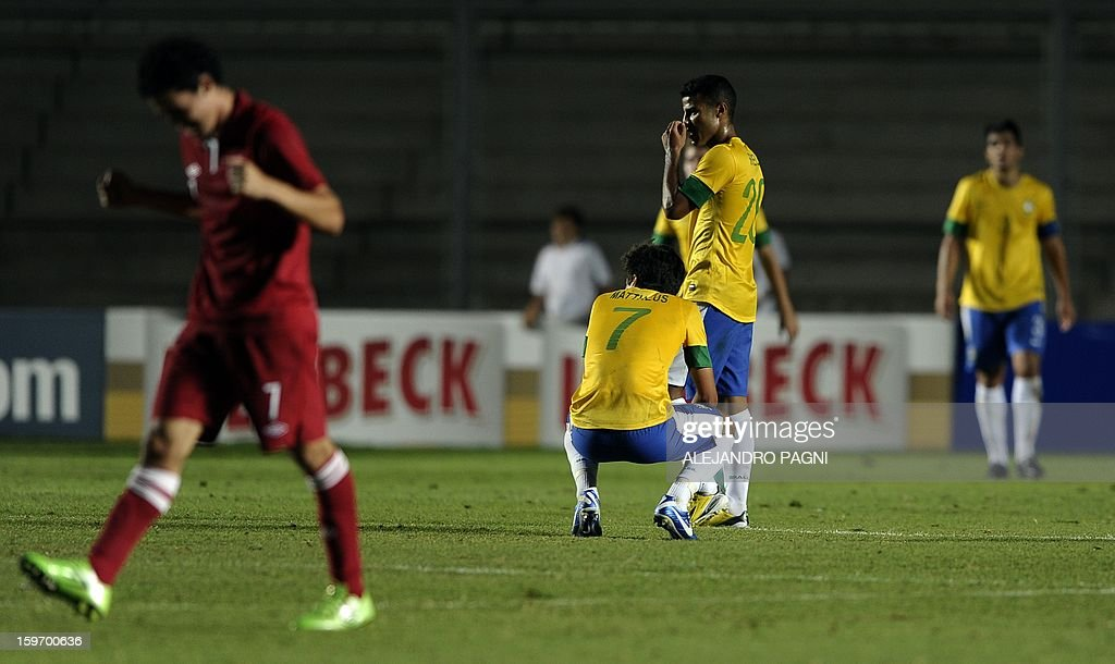 Brazilian footballers react in dejection after Peruvian midfielder Edison Flores (not in picture) scored the team's second goal during their South American U-20 Championship Group B football match, at Bicentenario stadium in San Juan, Argentina, on January 18, 2013. Four teams will qualify for the Turkey 2013 FIFA U-20 World Cup.