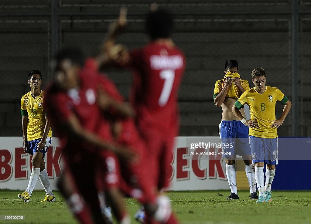 Brazilian footballers react in dejection after Peruvian midfielder Edison Flores (not in picture) scored his team's second goal during their South American U-20 Championship Group B football match,...