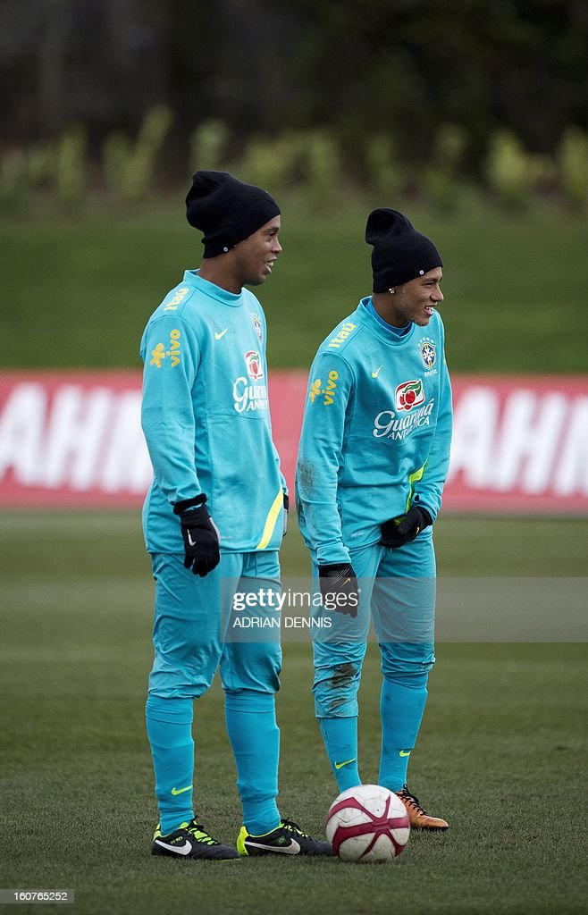 Brazilian footballers Ronaldinho (L) and Neymar (R) look on as they participate in a training session at The Hive, Barnet FC's training ground in Edgware, London on February 5, 2013. Brazil are set to play England in an international friendly at London's Wembley Stadium on February 6, 2013 . Ronaldinho admits he did not expect to be recalled by Brazil, but says he believes the squad he has returned to possesses sufficient quality to win the 2014 World Cup on home soil. After a year in the international wilderness, the 32-year-old forward is expected to feature in Brazil's friendly game against England at Wembley.