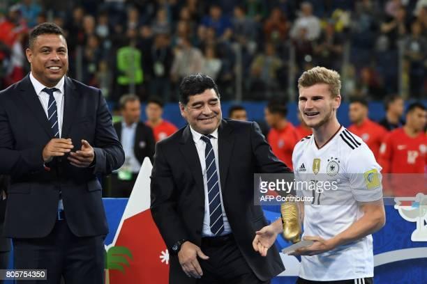 Brazilian former ace footballer Ronaldo and Argentinian former football ace Diego Maradona share a light moment as Germany's forward Timo Werner...