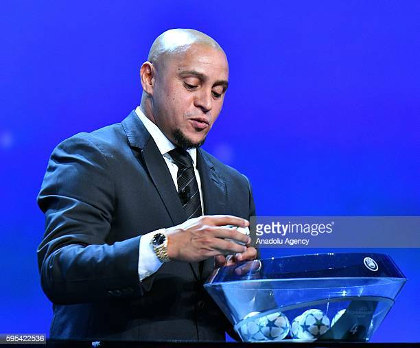 Brazilian former football player Roberto Carlos draws a ball during the UEFA Champions League Group stage draw ceremony at Grimaldi Forum in Monte...