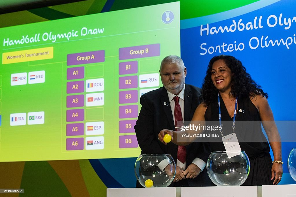 Brazilian former handball player Zeze Sales (R) and Danish Per Bertelsen, International Handball Federation (IHF) head of the commission of organizing and competition, during the Handball draw for the Rio 2016 Olympic games at Future Arena of Olympic Park in Rio de Janeiro, Brazil, on April 29, 2016. / AFP / YASUYOSHI
