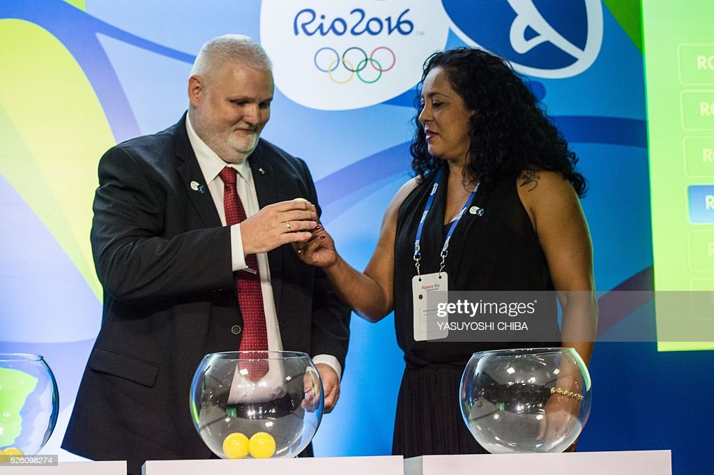 Brazilian former handball player Zeze Sales (R) and Danish Per Bertelsen, International Handball Federation (IHF) head of the commission of organizing and competition, during the Handball draw for Rio 2016 Olympic Games at Future Arena of Olympic Park in Rio de Janeiro, Brazil, on April 29, 2016. / AFP / YASUYOSHI