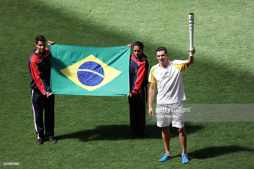 Brazilian former player <a gi-track='captionPersonalityLinkClicked' href=/galleries/search?phrase=Lucio&family=editorial&specificpeople=206116 ng-click='$event.stopPropagation()'>Lucio</a> holding the Olympic torch at Mane Garrincha stadium on May 3, 2016 in Brasilia, Brazil. The Olympic torch will pass through 329 cities from all states from the north to the south of Brazil, until arriving in Rio de Janeiro on August 5, to lit the cauldron.