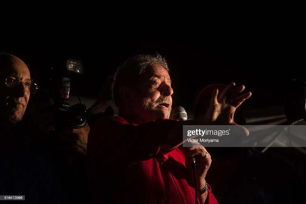 Brazilian Former President Luis Inacio Lula da Silva gives a speech to thousands of supporters out in protest on March 18, 2016, in Sao Paulo, Brazil. Former President <a gi-track='captionPersonalityLinkClicked' href=/galleries/search?phrase=Luiz+Inacio+Lula+da+Silva&family=editorial&specificpeople=211609 ng-click='$event.stopPropagation()'>Luiz Inacio Lula da Silva</a> had his temporary detention requested by the prosecutor of Sao Paulo for alleged involvement in funding shifts and corruption. A telephone recording between President Dilma Rousseff and former President Lula was released by the Federal Police, which seems to suggest that he was appointed into the cabinet in an attempt to avoid prosecution in the corruption scandal.