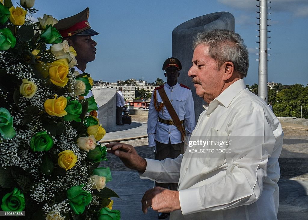 Brazilian former President Luiz Inacio Lula da Silva takes part in a wreath-laying ceremony at the Jose Marti monument at Revolution Square in Havana, on January 29, 2013. Lula is in Cuba to participate in the 3rd International Meeting for the Balanced World.