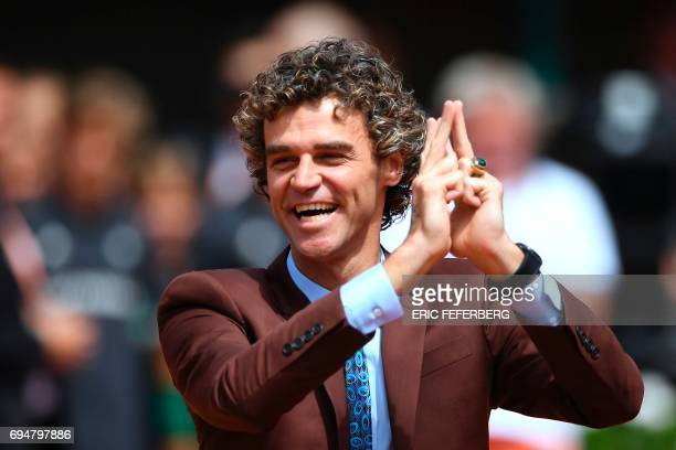 Brazilian former tennis player Gustavo Kuerten poses before men's final tennis match at the Roland Garros 2017 French Open on June 11 2017 in Paris /...