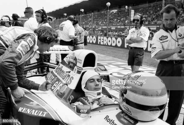 Brazilian Formula 1 race car driver Ayrton Senna in his car at the starting line before the San Marino F1 Grand Prix on the Imola Circuit Imola Italy...