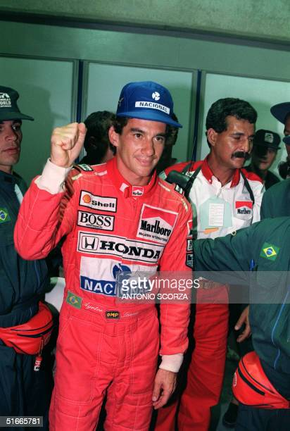 Brazilian Formula One champion Ayrton Senna celebrates his 54th carrier pole position 23 March 1991 for the Brazilian F1 Grand Prix