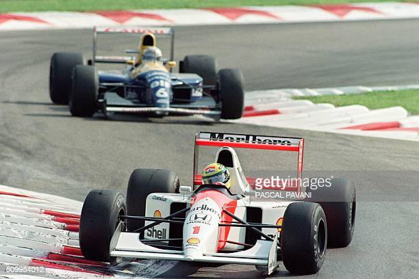 Brazilian Formula One driver Ayrton Senna steers his McLarenHonda round a bend followed by Ricardo Patrese of Italy during the Italian Grand Prix in...