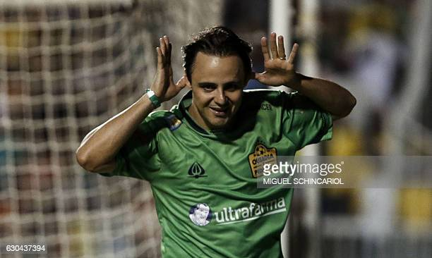 Brazilian Formula One driver Felipe Massa celebrates his second goal during the charity football match Ousadia vs Pedalada at Pacaembu stadium in Sao...