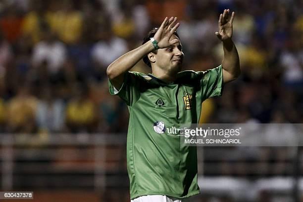 Brazilian Formula One driver Felipe Massa reacts during the charity football match Ousadia vs Pedalada at Pacaembu stadium in Sao Paulo on December...