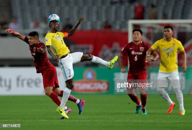 Brazilian forward Elkeson of China's Shanghai SIPG fights for the ball with Ramires Santos of China's Jiangsu FC during their AFC Champions League...