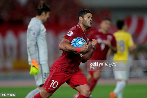Brazilian forward Hulk of China's Shanghai SIPG celebrates after scoring a goal during the AFC Champions League round of 16 football match against...