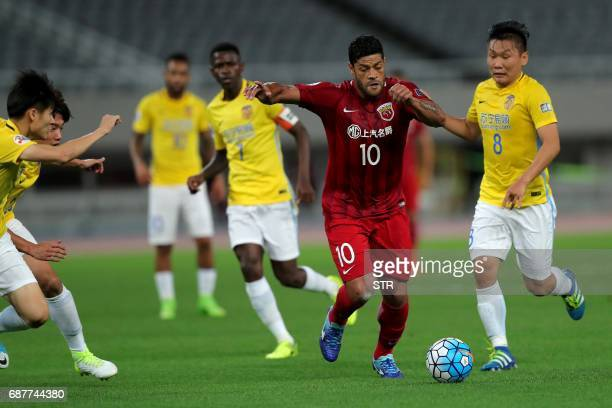 Brazilian forward Hulk of China's Shanghai SIPG fights for the ball with Liu Jianye of China's Jiangsu FC during their AFC Champions League round of...