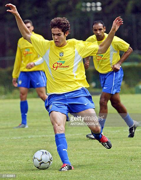 Brazilian forward Kaka of Italian Milan drives the ball observed by Emerson da Rosa of the Italian team Roma 14 November 2003 during a training...