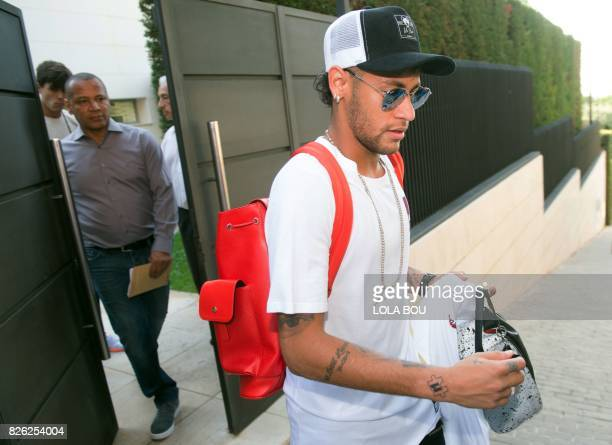 Brazilian forward Neymar and his father Neymar Santos leave the player's home in Barcelona to go to the airport on August 4 2017 Brazilian superstar...