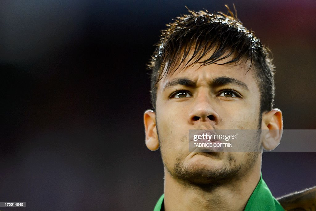 Brazilian forward Neymar grimaces prior to a friendly football match against Switzerland at the St Jakob Stadium on August 14, 2013 in Basel.