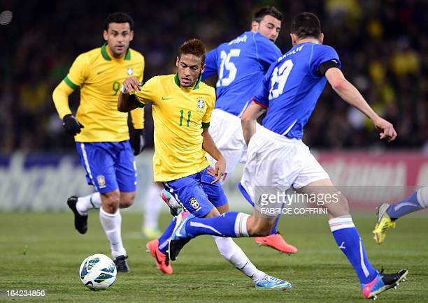 Brazilian forward Neymar Jr vies with Italian defender Leonardo Bonucci during the FIFA World Cup exhibition football match between Italy and Brazil...