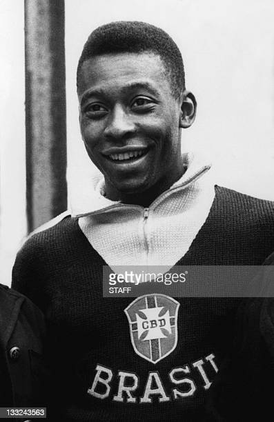 Brazilian forward Pele smiles as he poses for photographers in June 1962 in Vina del Mar a few days before a World Cup quarterfinal soccer match...
