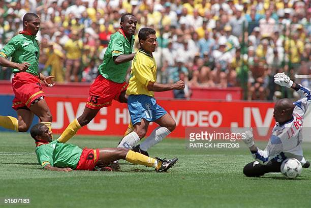 Brazilian forward Romario kicks the ball past Cameroon's goalkeeper Joseph Antoine Bell to score his team's first goal during their World Cup first...
