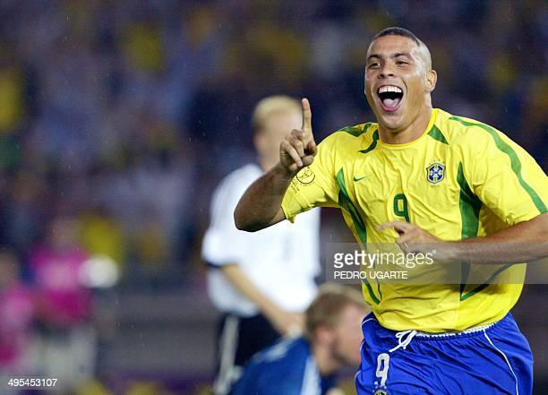 Brazilian forward Ronaldo celebrates after scoring the second Brazilian goal 30 June 2002 during the Germany/Brazil final of the 2002 FIFA World Cup...