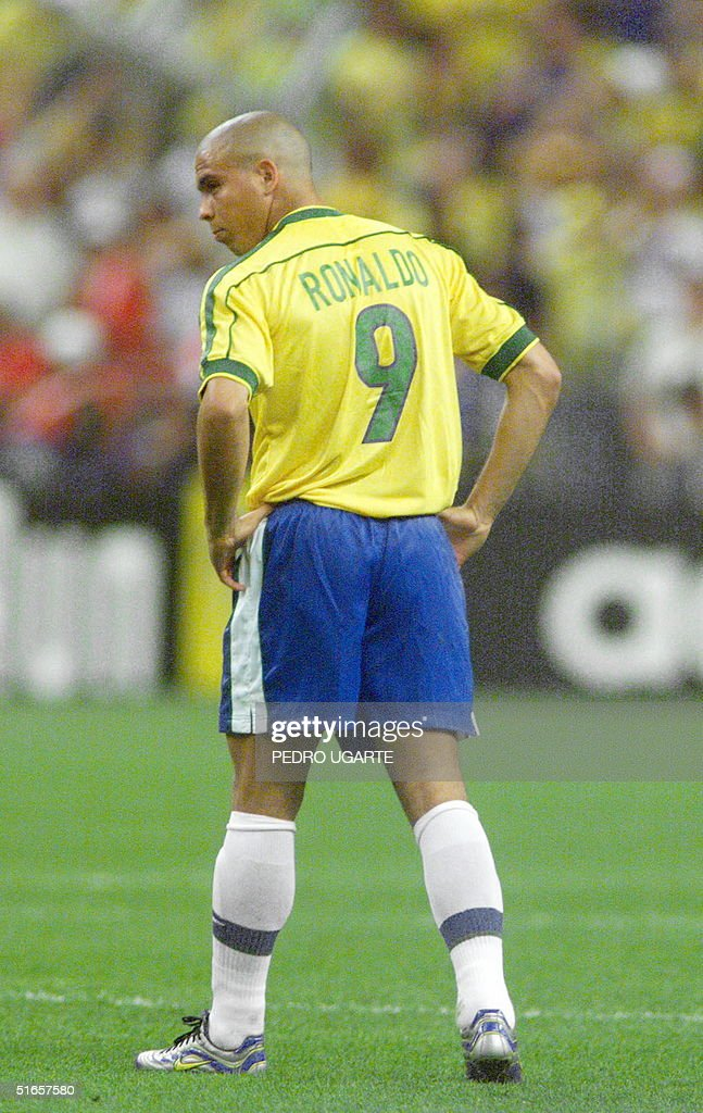 Brazilian forward Ronaldo reacts 12 July during the World Cup final match between Brazil and France at the Stade de France in Saint-Denis. France defeated Brazil 3-0 and won the 1998 FIFA Trophy.