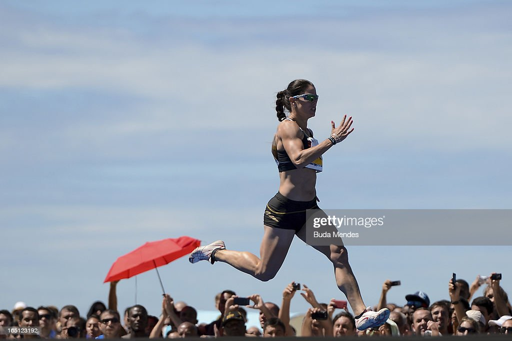 Brazilian Franciela Krasucki runs to win the 'Mano a Mano' Women's 150m challenge on Copacabana beach on March 31, 2013 in Rio de Janeiro, Brazil.