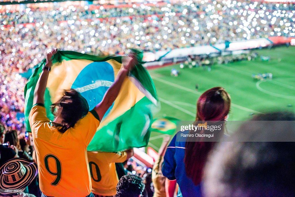 Brazilian fun in soccer game with flag : Stock-Foto