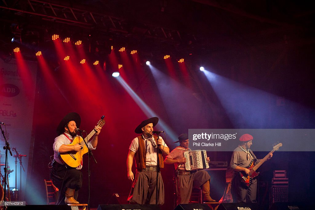 Brazilian Gaucho man in traditional dress singing and playing accordian and guitar on stage Reponte da Cancao music festival and song competition in...