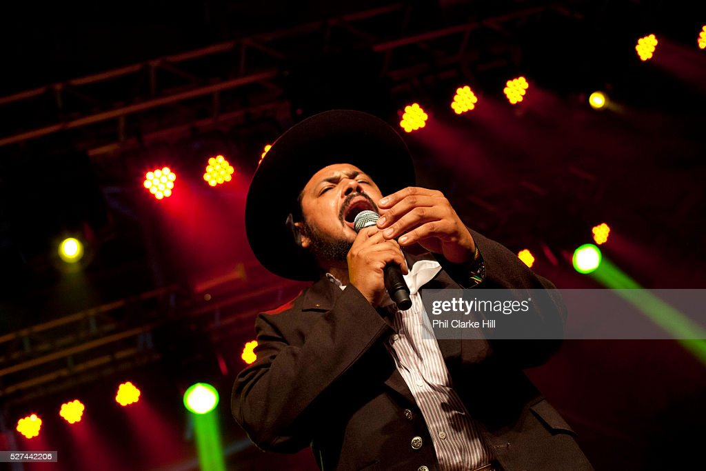 Brazilian Gaucho man in traditional dress singing passionately on stage Reponte da Cancao music festival and song competition in Sao Lorenzo do Sul...