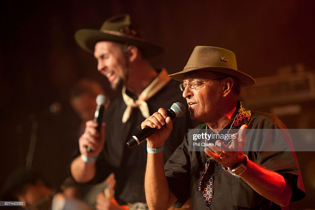 Brazilian Gaucho men in traditional dress singing passionately on stage Reponte da Cancao music festival and song competition in Sao Lorenzo do Sul...
