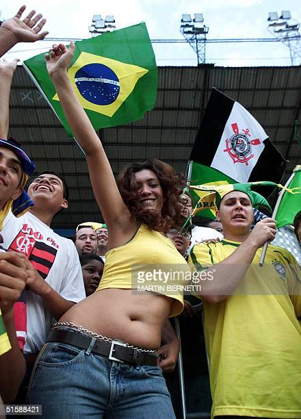 Brazilian girl dances samba in the tribunes of the Modelo Stadium in Guayaquil Ecuador 31 January 2001 during a game counting toward the XX South...