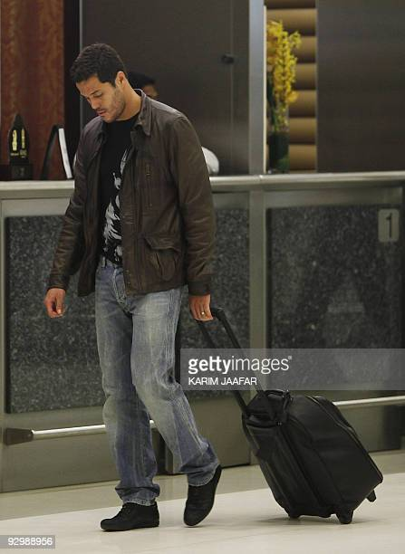 Brazilian GK Julio Cesar Soares de Espindola is pictured upon his arrival at Doha airport on November 11 2009 Brazil will face England on November 14...