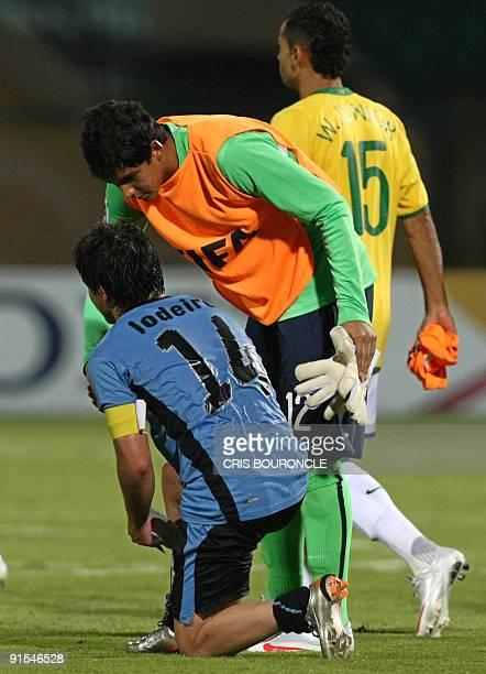 Brazilian goalkeeper Renan Ribeiro stops to congratulate Uruguay�s midfielder and team captain Nicolas Lodeiro for the good game played between...