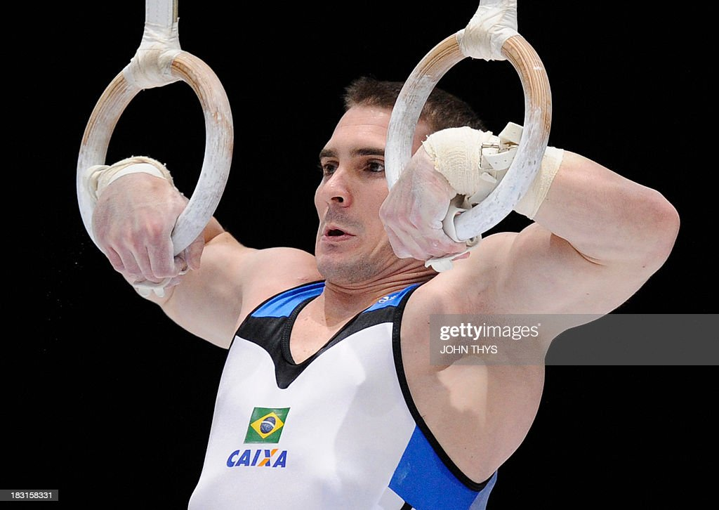Brazilian gold medalist Arthur Nabarrete Zanetti performs during the men's rings final of the world gymnastics championships in the Antwerp Sportpaleis hall, on October 5 2013.