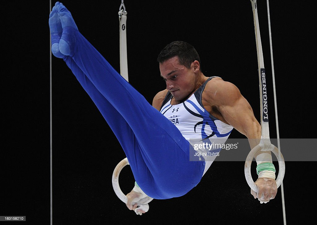 Brazilian gold medalist Arthur Nabarrete Zanetti performs on October 5 2013 during the men's rings final of the gymnastics world championships at the Antwerp Sportpaleis hall in Antwerp.