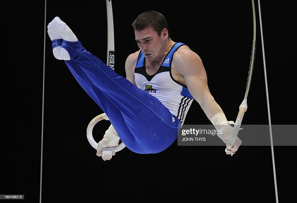 Brazilian gold medalist Arthur Nabarrete Zanetti performs on October 5 2013 during the men's rings final of the gymnastics world championships at the Antwerp Sportpaleis hall in Antwerp. AFP PHOTO /JOHN THYS