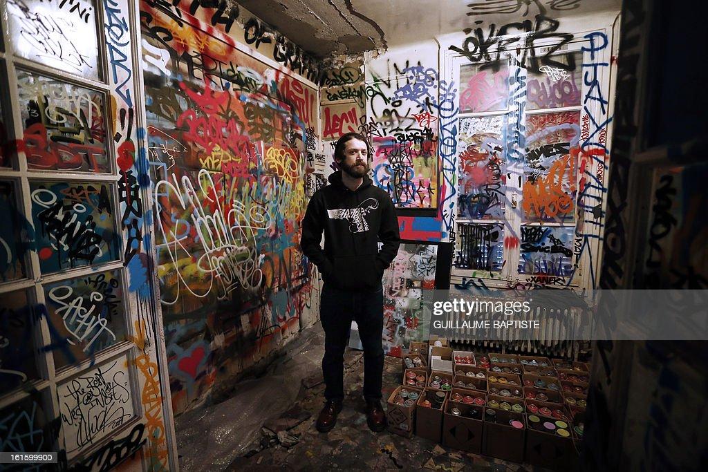 Brazilian Graffiti artist Herbert Baglione poses on February 12, 2013 at 'L'Atelier de l'Art sauvage' in Boulogne-Billancourt, near Paris.