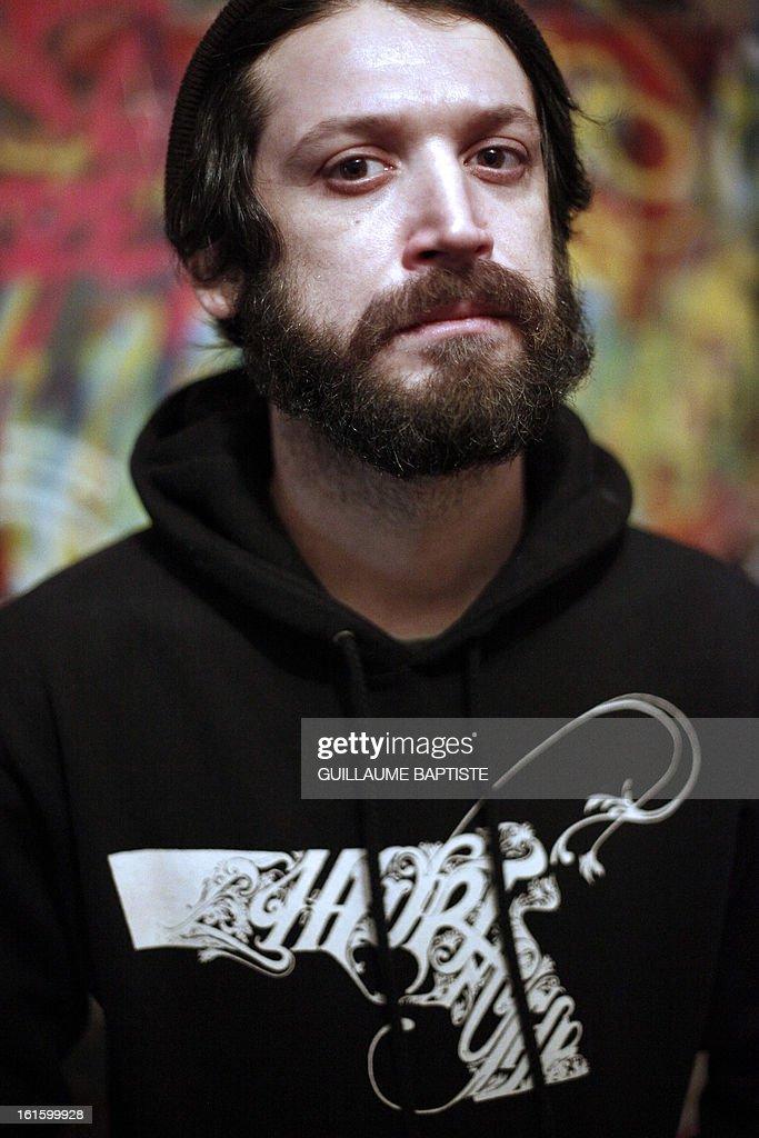 Brazilian Graffiti artist Herbert Baglione poses on February 12, 2013 at 'L'Atelier de l'Art sauvage' in Boulogne-Billancourt, near Paris. AFP PHOTO / GUILLAUME BAPTISTE