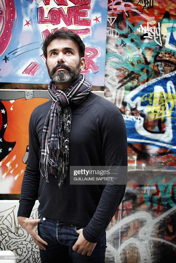 Brazilian Graffiti artist Speto poses on February 12, 2013 at 'L'Atelier de l'Art sauvage' in Boulogne-Billancourt, near Paris. AFP PHOTO / GUILLAUME BAPTISTE