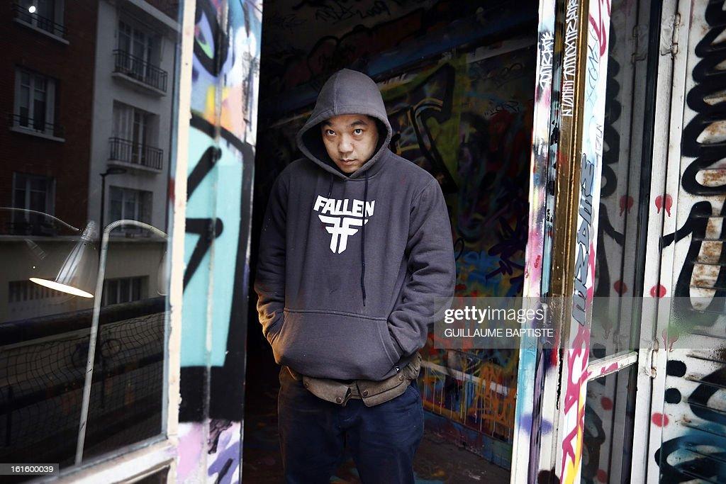 Brazilian Graffiti artist Walter Nomura, aka 'Tinho,' poses on February 12, 2013 at 'L'Atelier de l'Art sauvage' in Boulogne-Billancourt, near Paris.