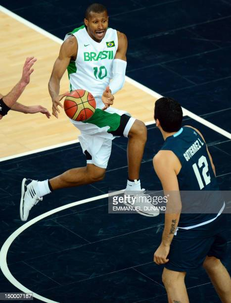 Brazilian guard Leandrinho Barbosa catches the ball during his team's London 2012 Olympic Games men's quarterfinal basketball match against Argentina...