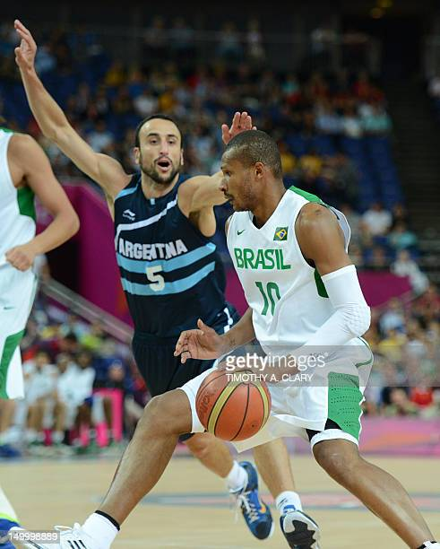 Brazilian guard Leandrinho Barbosa runs with the ball past Argentinian guard Emanuel Ginobili during their London 2012 Olympic Games men's...