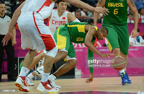 Brazilian guard Leandrinho Barbosa vies with Chinese guard Liu Wei during the men's preliminary round group B basketball match China vs Brazil of the...