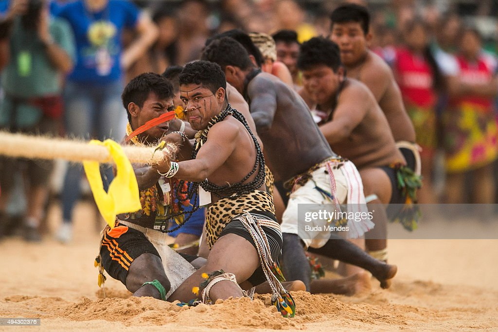 Brazilian indigenous natives participate in the tug-of-war competition of the first World Indigenous Games on October 25, 2015 in Palmas, Brazil.