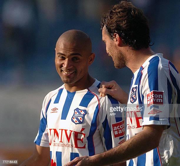 Brazilian international striker Afonso Alves of Heerenveen is congratulated by an unidentified teammate after scoring seven goals vs Herakles Almelo...