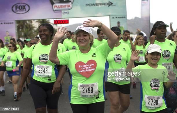 Brazilian Ivonette Balthazar who was submitted to a heart transplant one year ago participates in a threekilometre fun run alongside Copacabana beach...