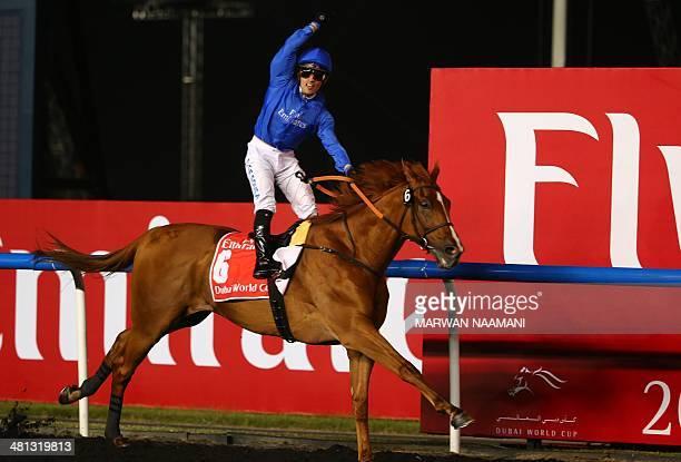 Brazilian jockey Silvestre De Sousa celebrates after crossing the finish line on African Story the horse of the Ruler of Dubai Mohammad bin Rashid...