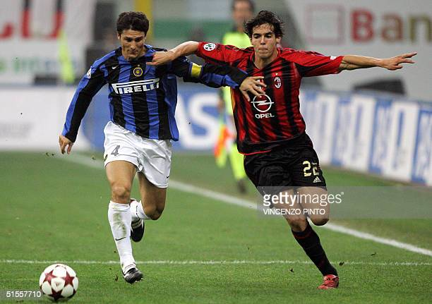 Brazilian Kaka of AC Milan vies Argentine Javier Zanetti of InterMilan during their Italian Serie A football match at Meazza stadium in Milan 24...